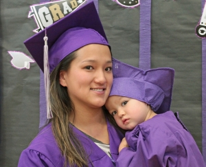 A Florence Crittenton mother graduating from high school and her child graduating from the early education childhood center